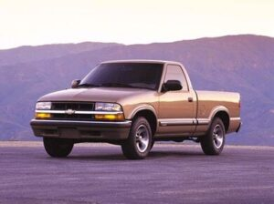 A stock photo of a tan Chevy S-10 truck
