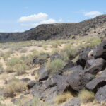 Photo of hills, rocks and dirt and the Petroglyph National Monument in Albuquerque.