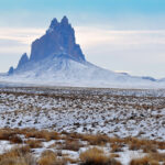 Photo of Shiprock on a snowy day.